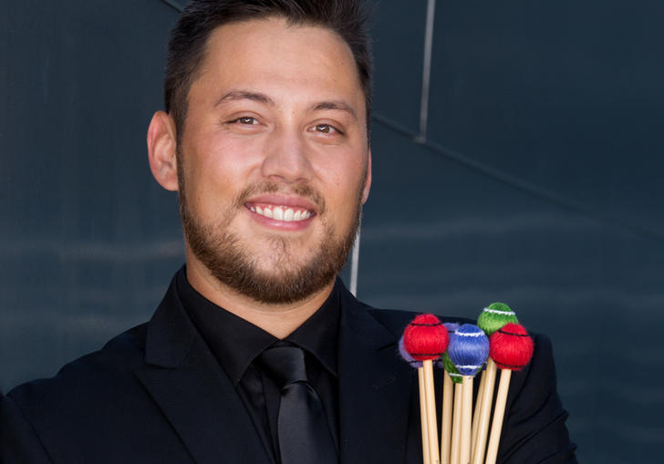 Matthew Howard with percussion sticks