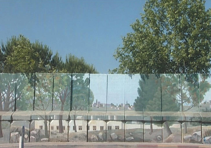 an image of a glass wall with blue sky and trees behind it