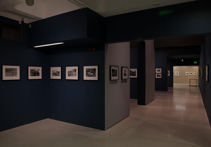 Gallery with blue walls and phtographs