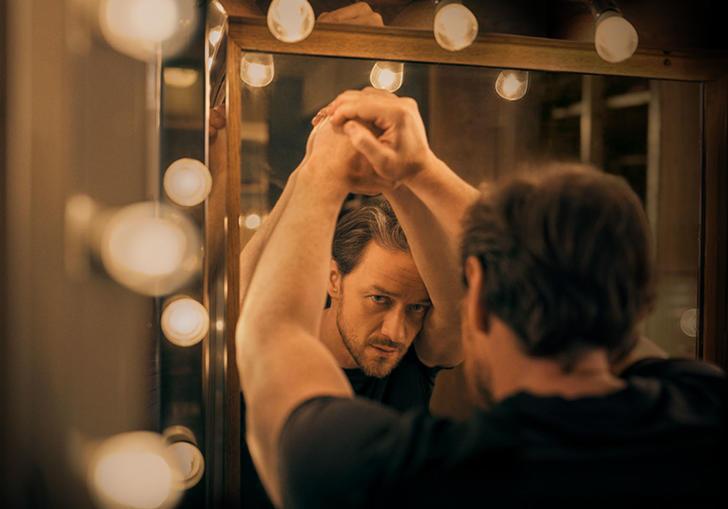 James McAvoy reflected in a mirror