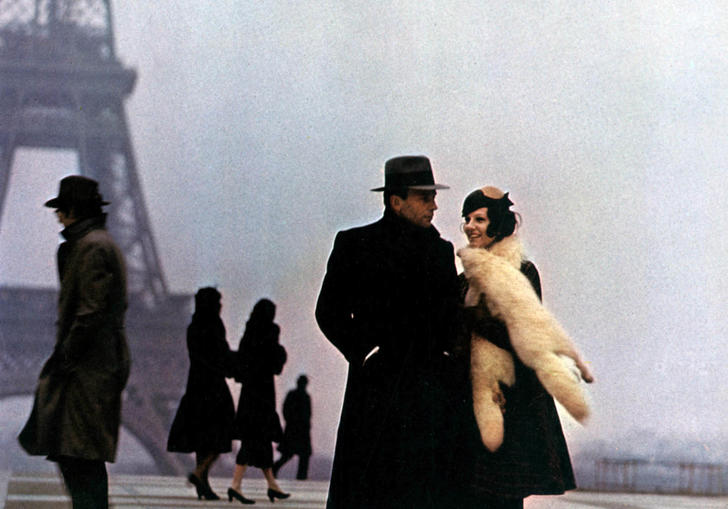 Jean-Louis Trintignant and Stefania Sandrelli stand bundled in winter coats on a grey day by the Eiffel Tower in Bertolucci's The Conformist