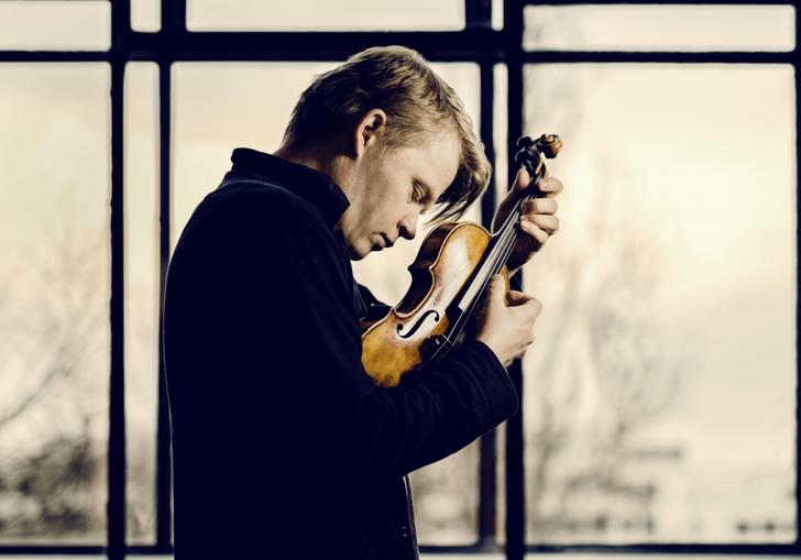 Pekka lost in the moment as he passionately plays his violin
