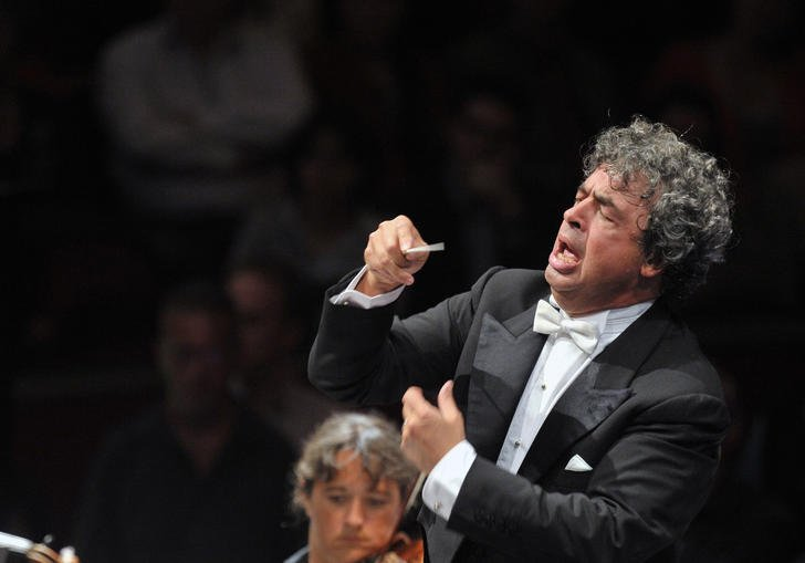 Seymon conducting with great passion and vigor