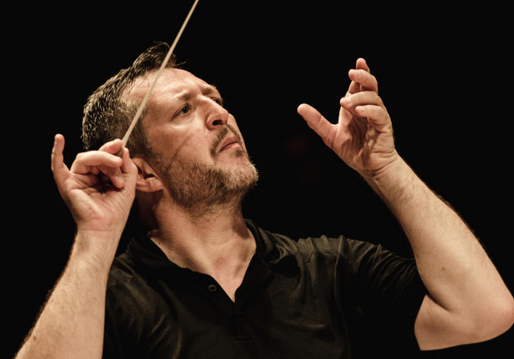 Thomas Ades conducting vigorously