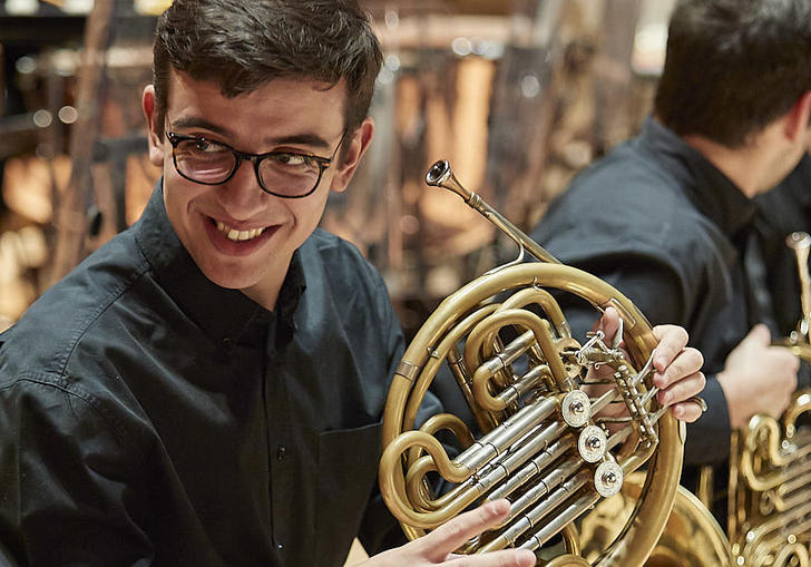 Guildhall School horn player smiling