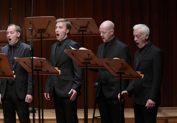 Four of the men of BBC Singers singing