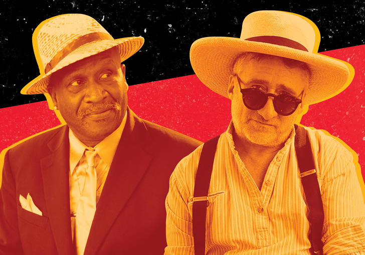 image taken from Taj Mahal & Jon Cleary's 'Hoo Doo Blues' flyer. Sepia toned image of two men wearing hats, one wears sunglasses and braces, the other wears a suit and carries a ukelele