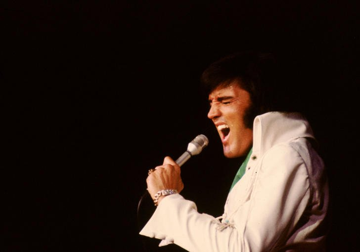 Elvis singing into a microphone