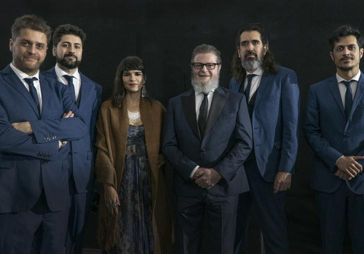 A portrait of Gustvao Santaolalla and his band