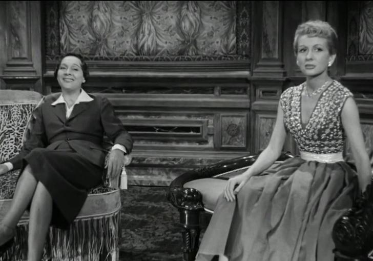 two women sitting in a lounge-like room