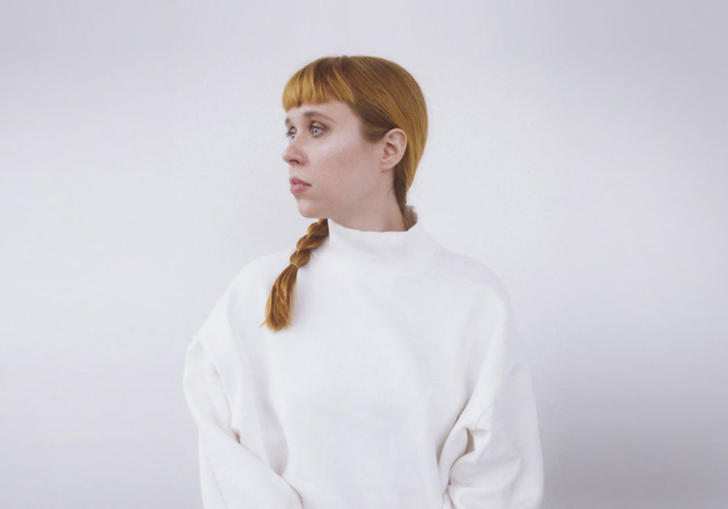 photo of holly herndon dressed in white