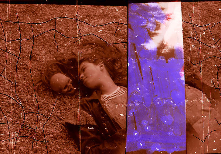 A girl likes on a floor next to a skull, with a purple strip in A Different Category