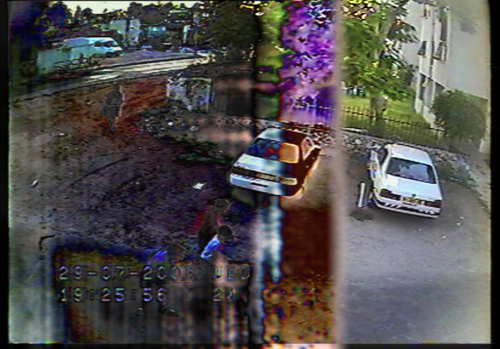 A CCTV image of a car park in An Unusual Summer