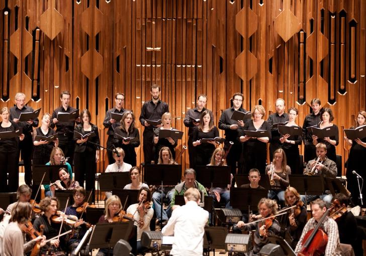 A landscape image of Britten Sinfonia Voices on stage