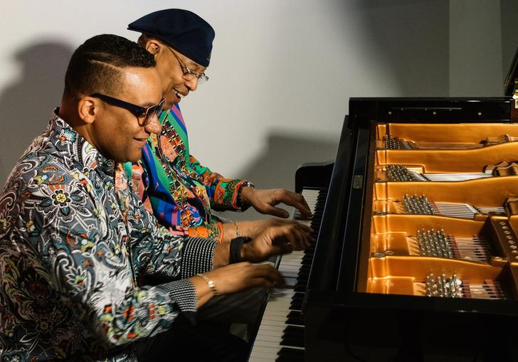 Chucho and Gonzalo playing the piano