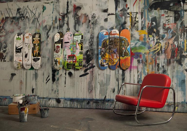 Photo of skateboards with Basquiat artwork