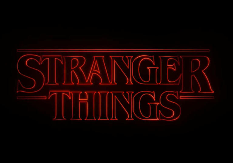 Stranger Things lit up in an eerie red colour