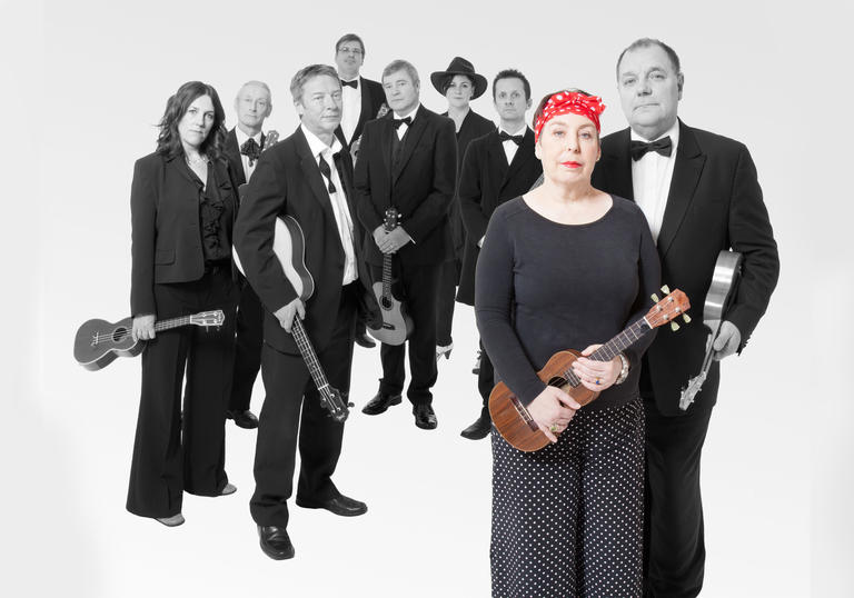 Kitty Lux at the front of the Ukulele Orchestra of Great Britain