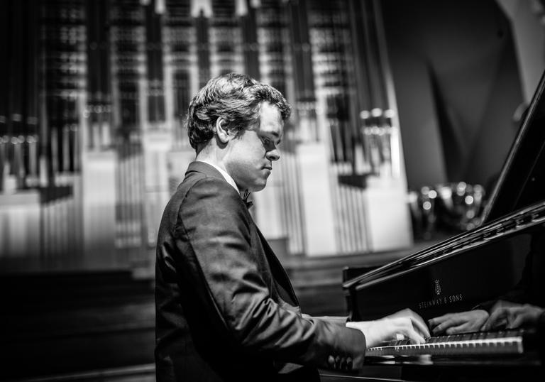 Benjamin Grosvenor playing piano black and white