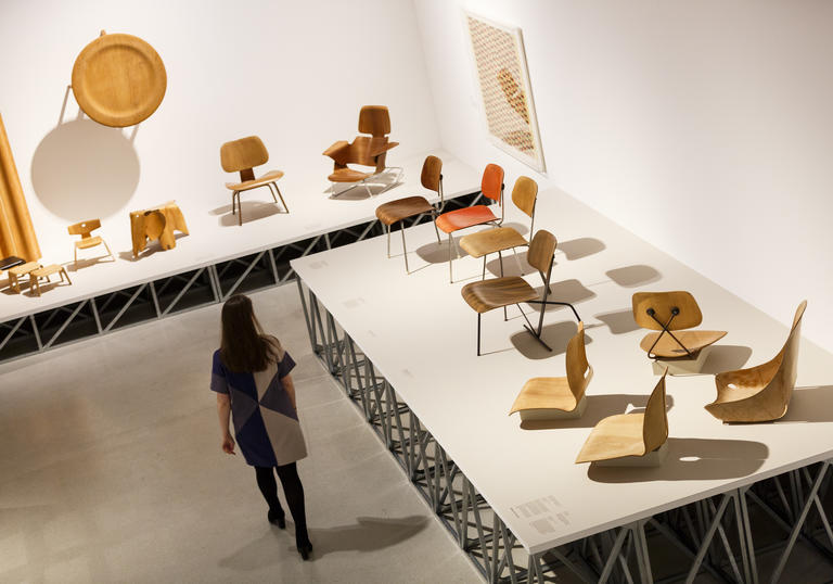 Woman walking through a room of chairs