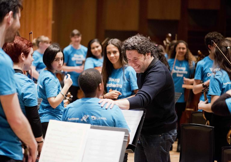 Gustavo Dudamel with young musicians from the Young Orchestra East