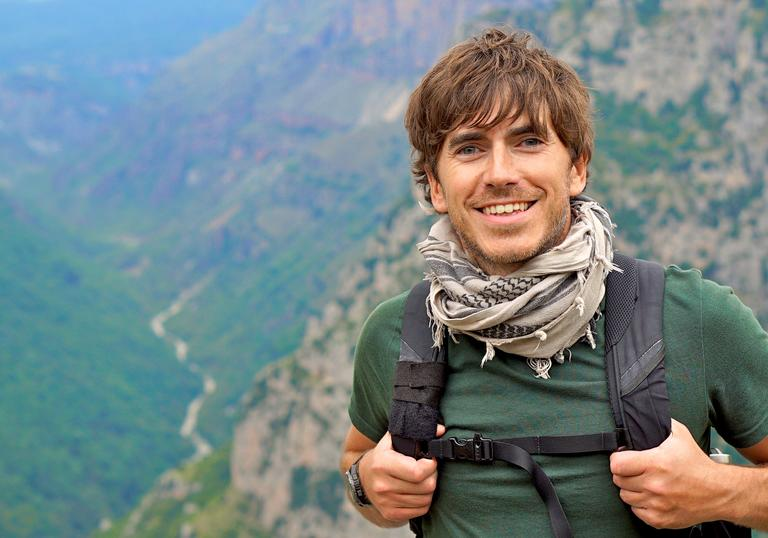 Simon Reeve on a mountain