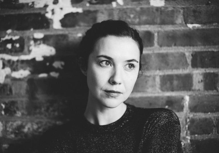 Lisa Hannigan standing in front of a brick wall