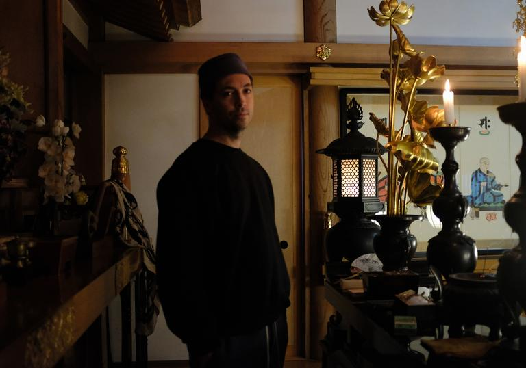 Tim Hecker standing in a temple
