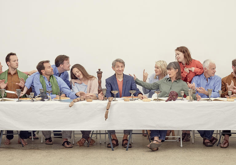 Robert Hollingworth and I Fagiolini sitting at a table