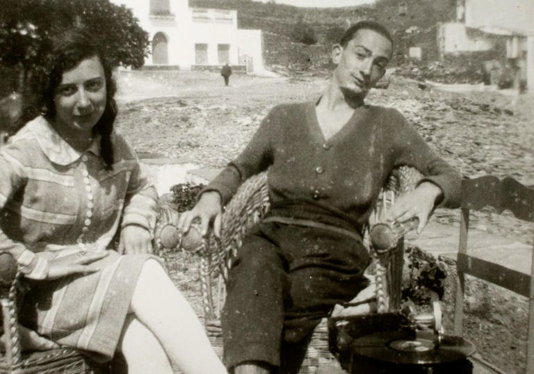 A black and white photo of Salvador Dalí and his muse, Gaya