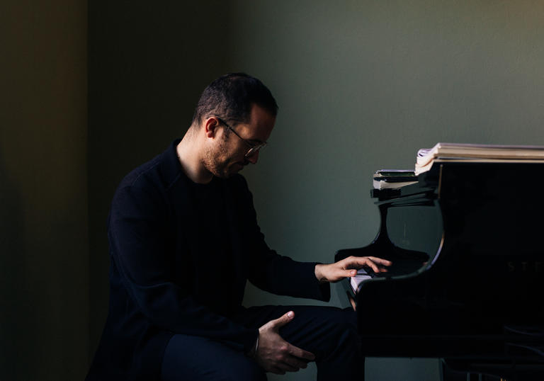 Igor Levit sitting at piano