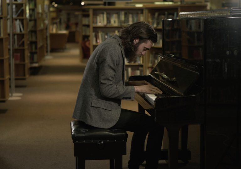 Keaton Henson on the piano in the Library