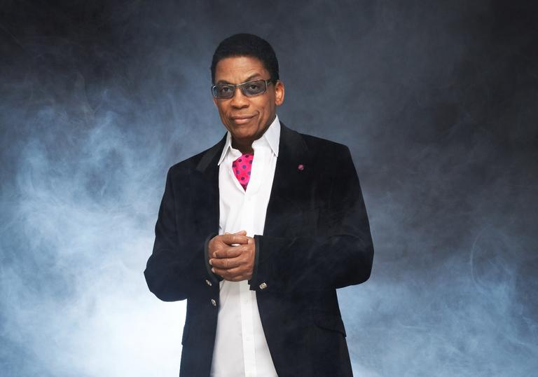 Herbie Hancock wearing a suit and pink cravat