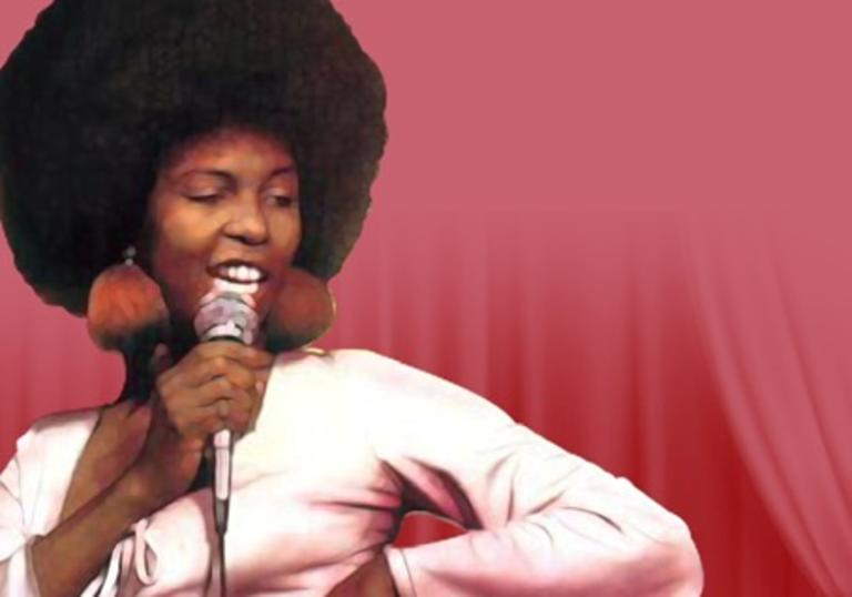 Betty Wright with one hand on her hip