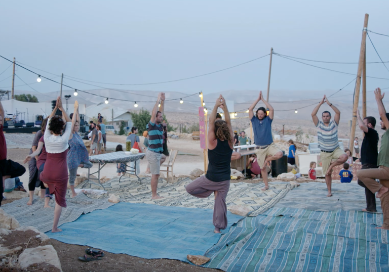 A group doing yoga in the open air.