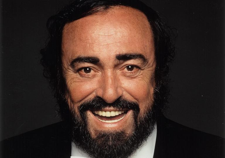 Image of smiling Pavarotti in bow tie