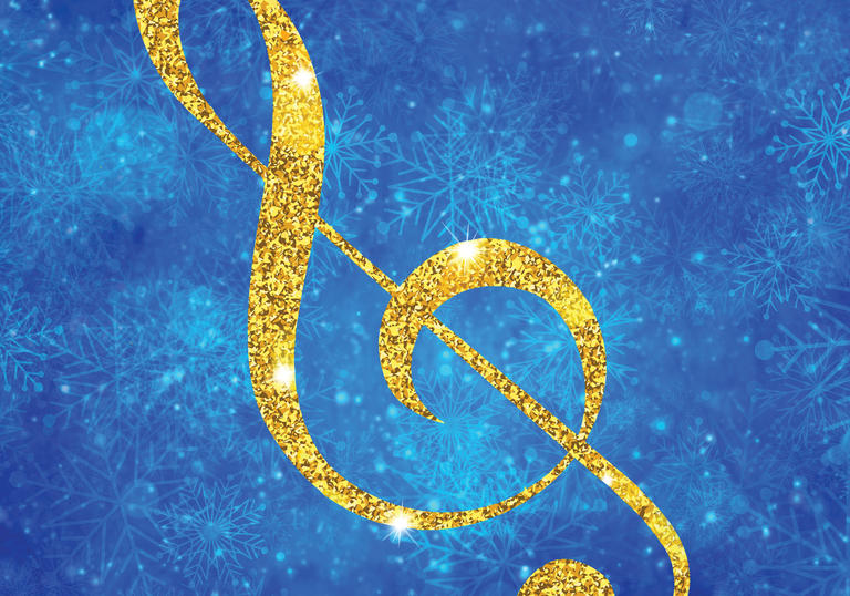 A glittering treble clef on a background of falling snowflakes