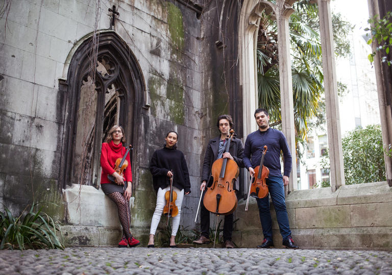Portorius String Quartet pictured outside holding instruments