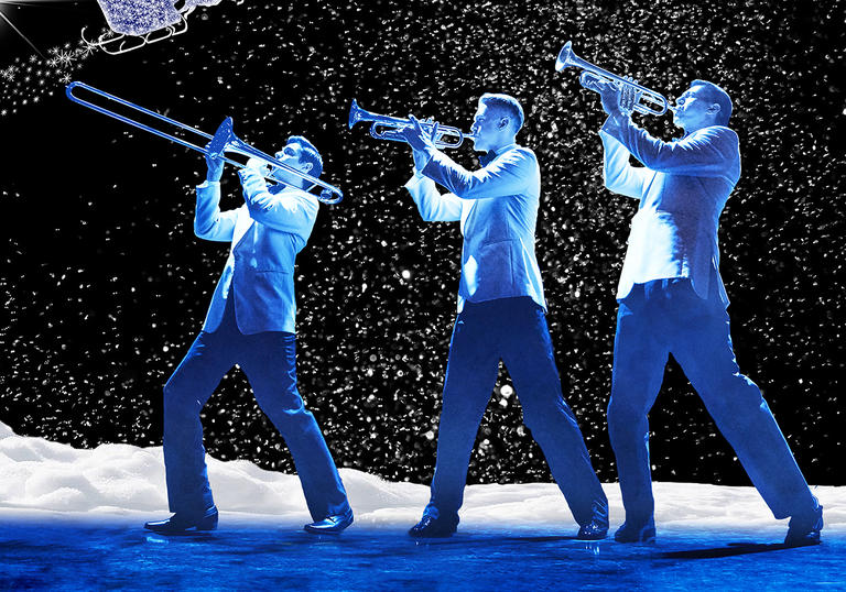 Image of three men playing trumpet, the two vocalists and the conductor