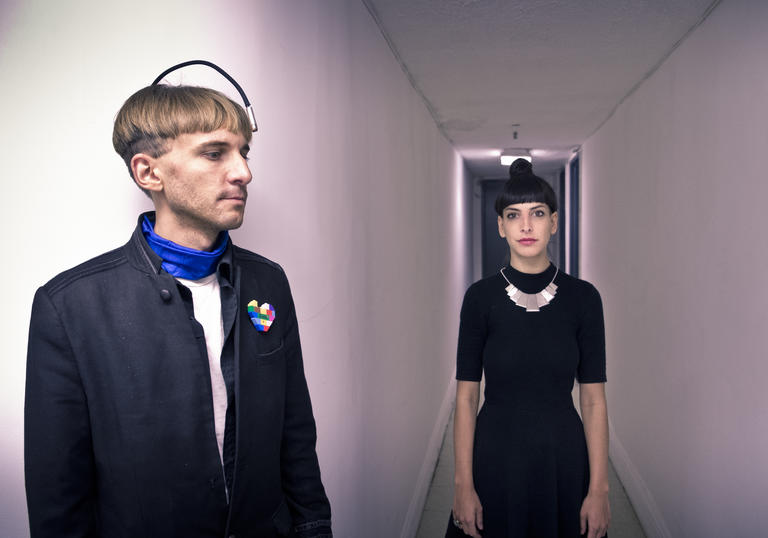 An image of Neil Harbisson and Moon Ribas gazing into the distance