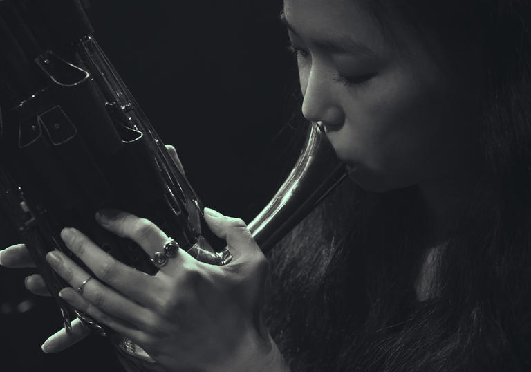 Park Jiha playing a traditional wind instrument