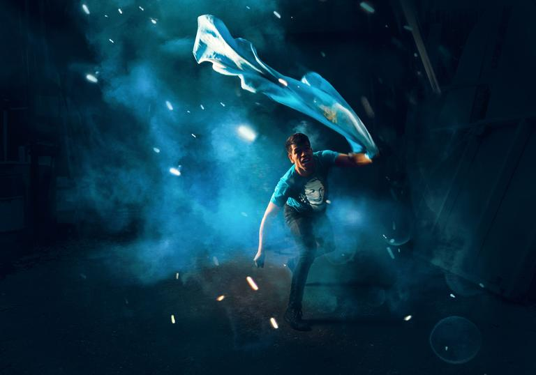 blue environment, man running with Argentinian flag