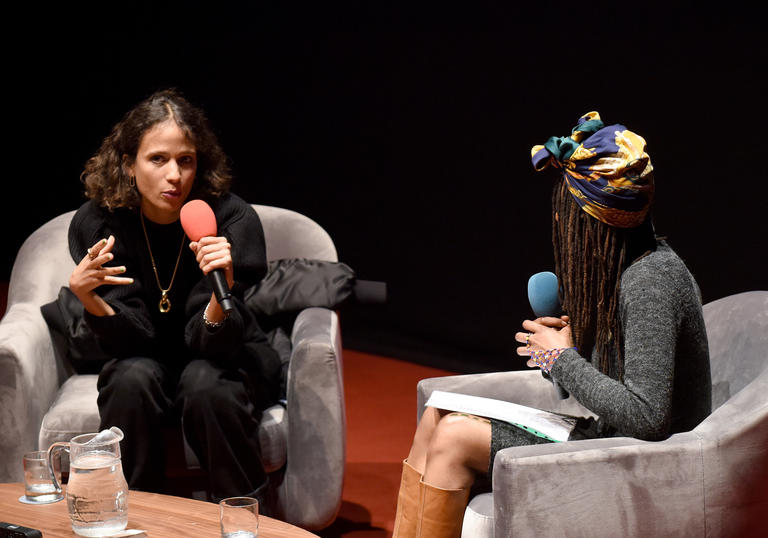 Mati Diop and Be Manzini talk on stage at the Barbican Cinema
