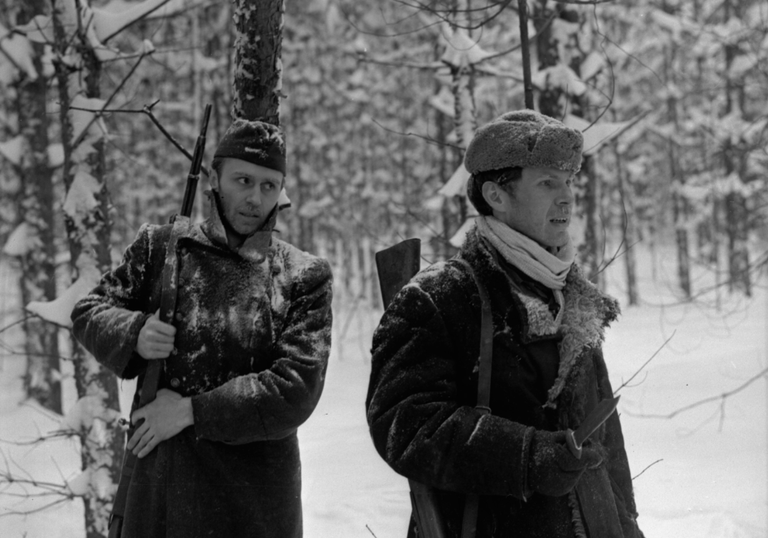 Two Russian soldiers walk through snowy woods in The Ascent