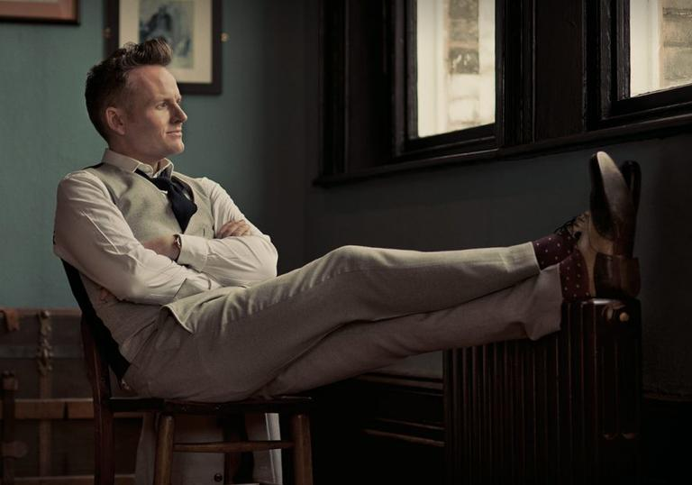 Joe Stilgoe pictured sitting down with feet up and arms crossed