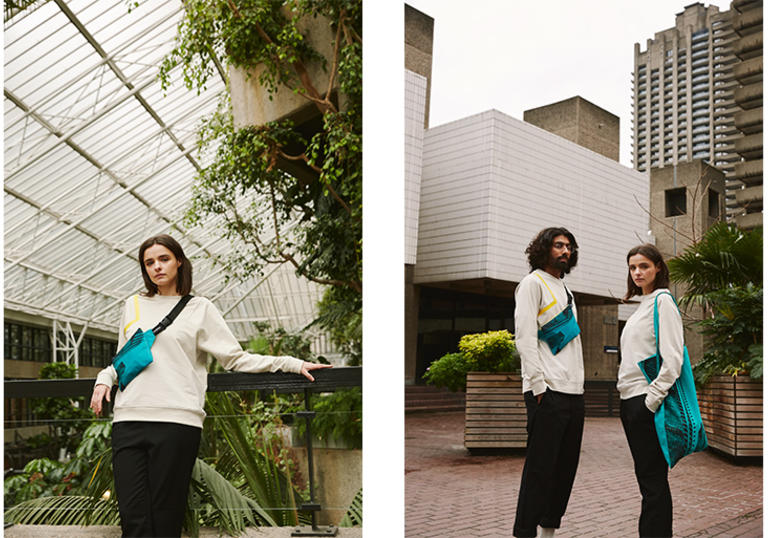a man and a woman wearing the apparel and lovers collection and standing in front of the barbican