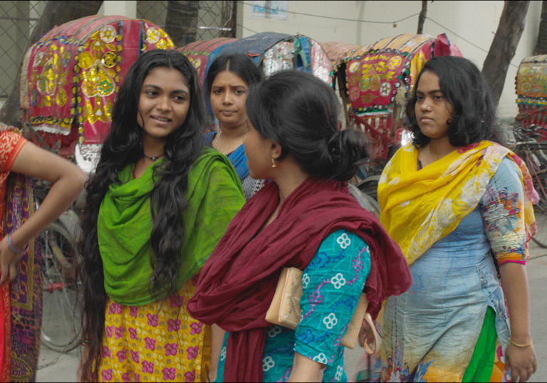 group of Bangladeshi women walk down the street