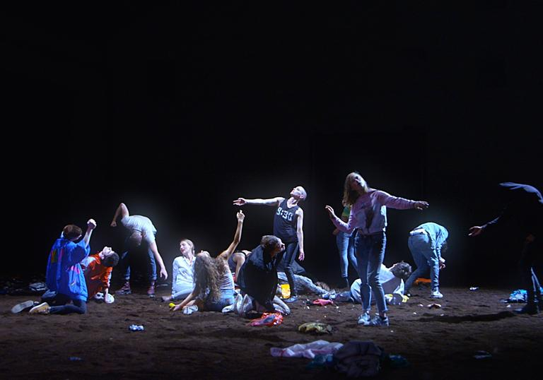 A group of dancers on a stage in a still from If It Were Love