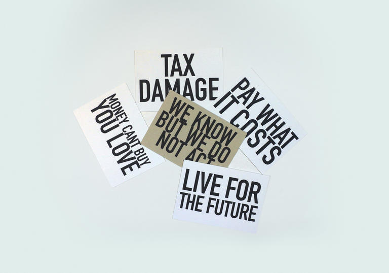 An image with different postcards which have slogans such as: Money Can't Buy You Love, We Know But We Do Not Act, Pay What It Costs, Tax Damage, Live For The Future