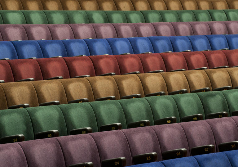 Photo of multicoloured seats in the Barbican Hall